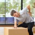 A man who injured his back while moving boxes