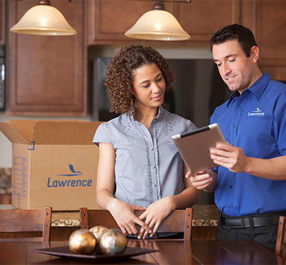 A corporate relocation expert goes over a move with the customer.