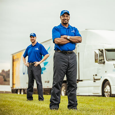 Two movers standing in front of a United Van Lines moving truck.