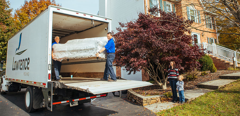Movers unloading a moving truck