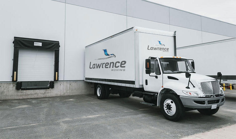 A Lawrence Moving truck backed up to a loading dock.