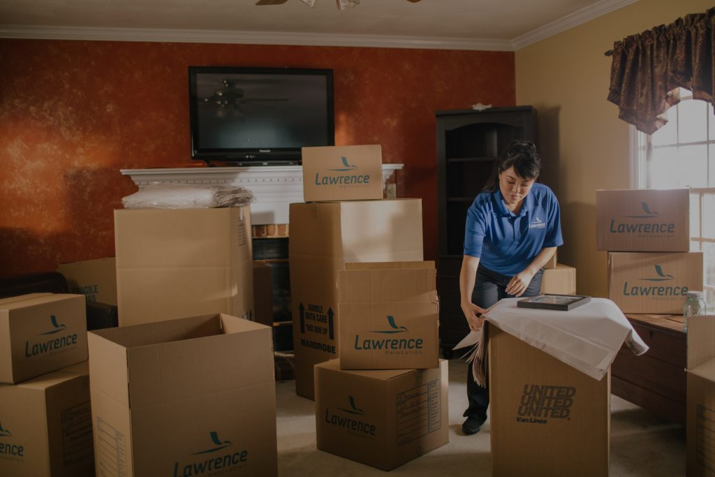 woman moving company packing boxes
