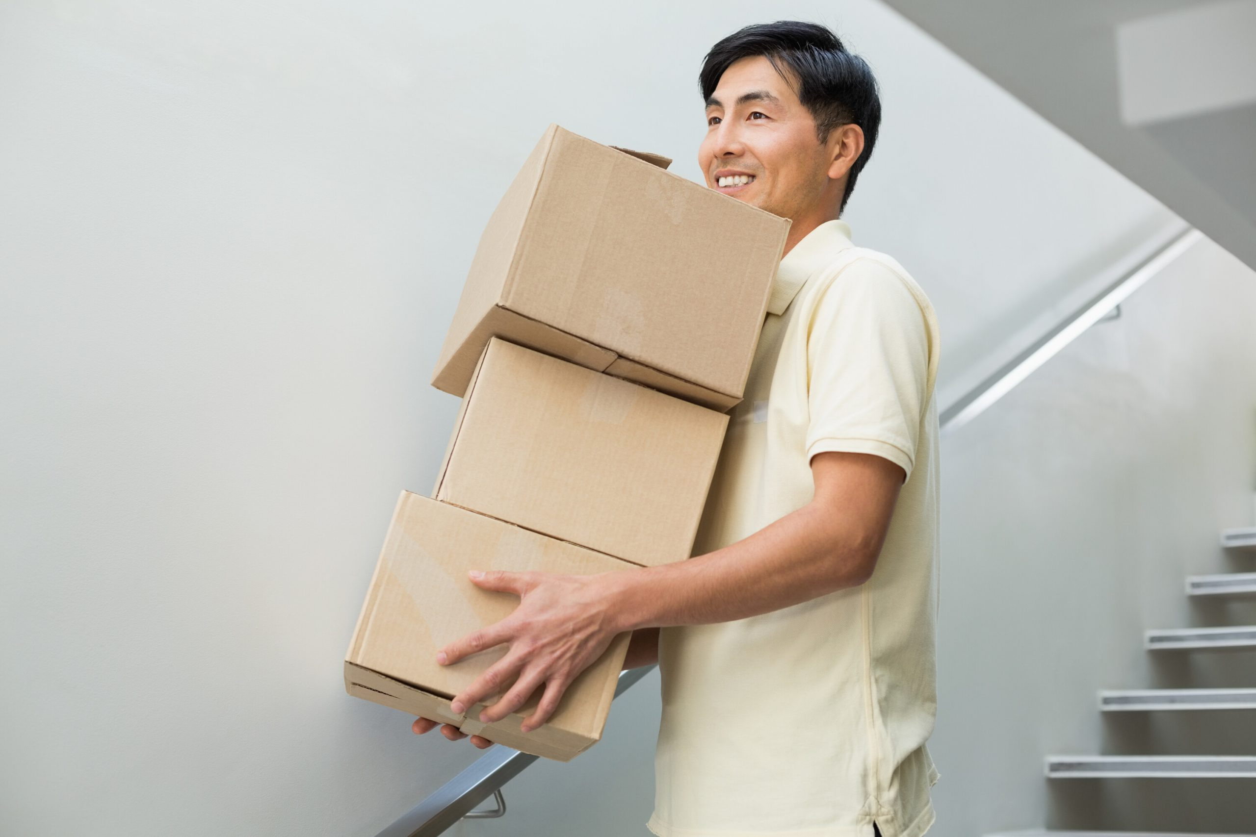 Man carrying moving boxes down steps